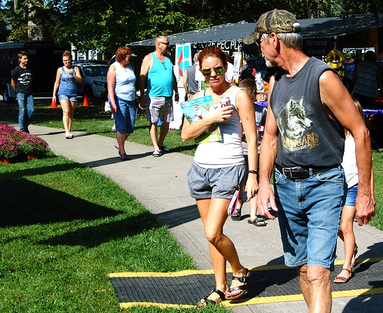 Debbie Blank | The Herald-Tribune<br /> In addition to a variety of entertainment and food, Applefest attendees checked out wares at business and craft booths.