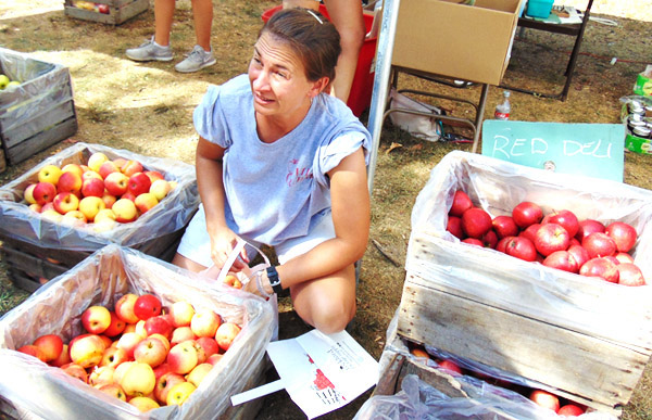Deanne Kaiser was busy all day Saturday bagging Villa Orchard apples for customers.