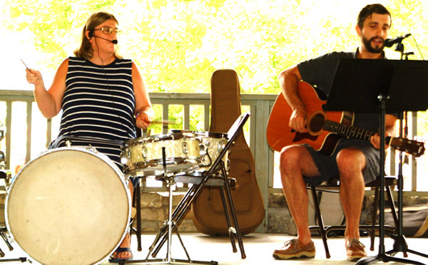 "Christa Mullins (left), Dillsboro, plays drums to ""Jailhouse Rock,"" the first of three tunes she presented, with the help of Keys to Success music therapist Yemani Schneider."