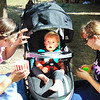 13-month-old Lucas (center) gets ready to check out merchandise at Applefest booths with mom Ruthann Collins (right) and aunt Missy Collins, Holton.