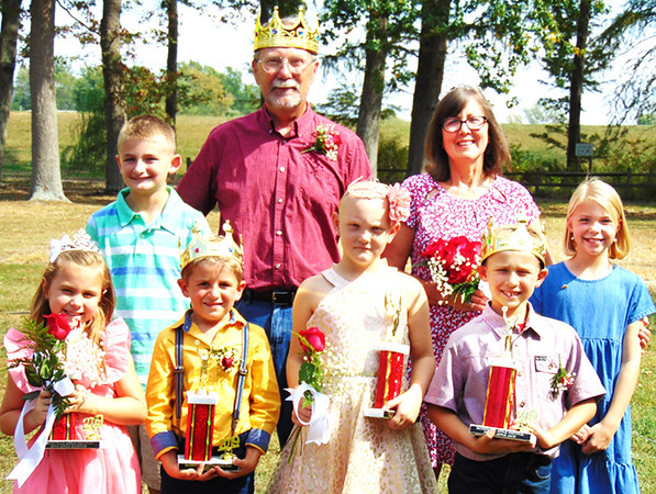 Applefest King Bruce Dickman and Queen Connie Rozman (back row center) were chosen because of essays written by fourth-graders Owen Beckner (left) and Mary Kara Wanstrath (right). Four young royals were selected at Saturday's pageant: (front row from left) Miss Apple Blossom Paislee Pennington and Mr. Apple Bud Graham Hofer, both kindergartners; Princess Apple Dumpling Dakota Thornburg and Prince Apple Jack Brady Horstman, both second-graders.