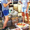 Judy Eckstein (right) of Villa Orchard, Oldenburg, is among about two dozen family members who work feverishly to bring apples and apple products to the fest. She chats with Jill Weber, Batesville, who took home a bag of apples and cider.