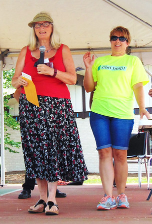 Diane Raver | The Herald-Tribune<br /> Food and Growers Association members Mary Meyer (left) and Deanna Hookway prepare to announce the Salsa Cook-off winners.