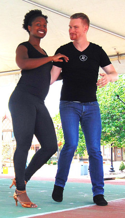 Diane Raver | The Herald-Tribune<br /> Ashley Donaldson and Kyle Culmann, Indianapolis, presented a salsa dancing demonstration on the stage.