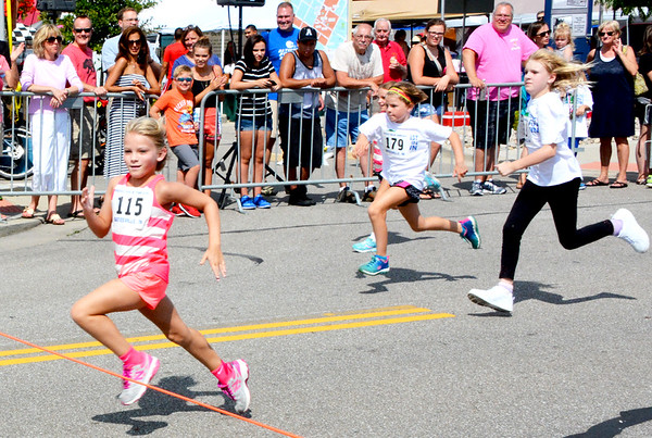 Christopher Aune | The Herald-Tribune<br /> X-year-old XXX was a hot pink streak to the finish line.