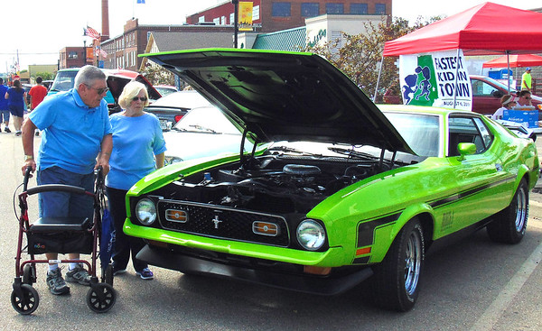 Diane Raver   The Herald-Tribune Mike and Pat Woolery, Batesville, check out one of the cars on display at the Batesville Area Chamber of Commerce's Classic Car Cruise-In.