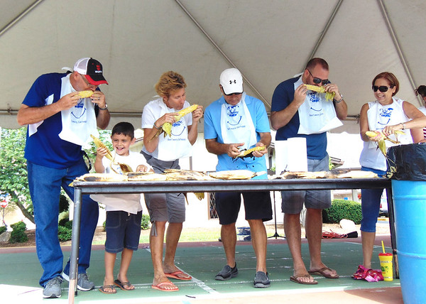 Diane Raver | The Herald-Tribune<br /> Jeff Ramey (from left), Winfall; Nathan Brown, Swayzee; Carolyn Dieckmann, Batesville; Bill Flannery, Batesville; Eric Kasch, North Carolina; and Bette Brody, Maryland; were some of the participants in the Corn on the Cob Eating Contest sponsored by the Batesville Young Professionals. This was just one of many events at the Batesville Bash Saturday. More photos are on page 4 and on our website.