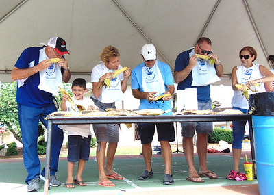Diane Raver   The Herald-Tribune Jeff Ramey (from left), Winfall; Nathan Brown, Swayzee; Carolyn Dieckmann, Batesville; Bill Flannery, Batesville; Eric Kasch, North Carolina; and Bette Brody, Maryland; were some of the participants in the Corn on the Cob Eating Contest sponsored by the Batesville Young Professionals. This was just one of many events at the Batesville Bash Saturday. More photos are on page 4 and on our website.