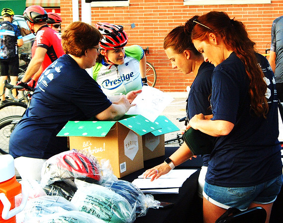 Debbie Blank | The Herald-Tribune<br /> The seventh annual Batesville Bash Saturday, Aug. 4, went from 8 a.m.-11 p.m. downtown. Vélo in the Ville , sponsored by St. Andrews Health Campus  to benefit Margaret Mary Health Foundation, was a noncompetitive cycling event with 6-, 20- and 62-mile routes. MMHF executive director Mary Dickey (left) and others send off the entrants.