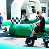 Debbie Blank | The Herald-Tribune<br /> One way to create your own breezes on a sweltering afternoon is to hop on a trike in the Children's Health Care Kids Zone.