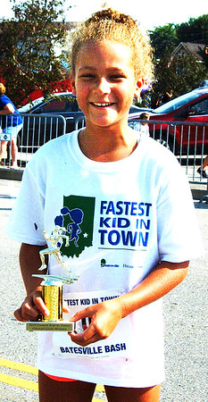 Debbie Blank | The Herald-Tribune<br /> Mimi Smith, the daughter of Leon and Meg Smith, is proud of her Fastest Girl in Town trophy.