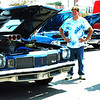 Debbie Blank | The Herald-Tribune<br /> Dan Perdue (from left), Batesville, shows his 1974 Cutlass S to David Tays, Greensburg, and his son Dusty, 17, at the midday Chamber Classic Car Cruise-In.