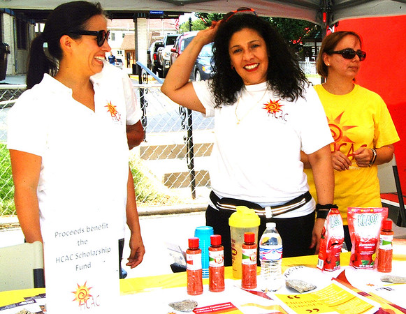 Debbie Blank | The Herald-Tribune<br /> Hispanic Community Advisory Committee members (from left) Jodi Alexander, Mayra Adams and Rocio Whitelock sell three kinds of thirst-quenching drinks (watermelon, hibiscus and pineapple) to raise scholarship funds.