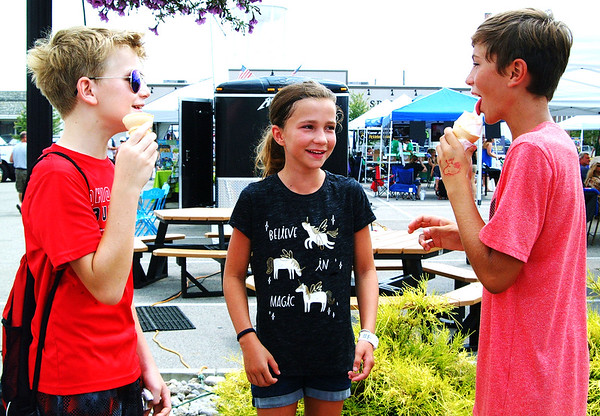Debbie Blank | The Herald-Tribune<br /> After sampling 11 different salsas, Thomas Lohmueller (from left), 12; Ella Carpenter, 10, and brother Ian Carpenter, 13, Batesville, keep cool with ice cream cones.