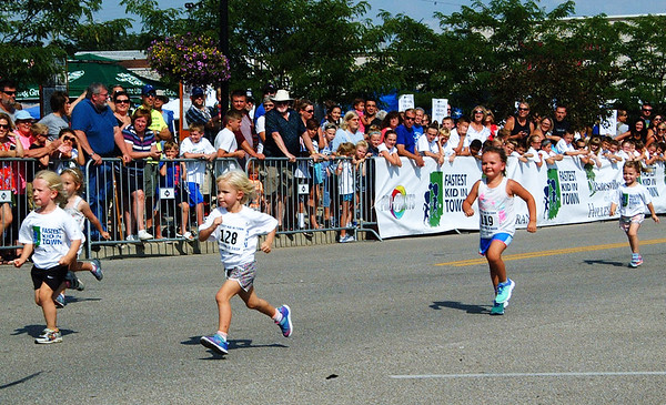 Debbie Blank | The Herald-Tribune<br /> The 3-year-old girls heat was competitive.