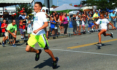 Debbie Blank | The Herald-Tribune Jacob Stenger, 11, became the 2018 Fastest Kid in Town late Saturday afternoon. First he had to win the 11-year-old males heat, then beat out 10 other age group winning boys in another race to become the Fastest Boy in Town. Finally, Stenger, edged out the Fastest Girl in Town, Mimi Smith, 9, to become the overall swiftest.
