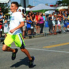 Debbie Blank | The Herald-Tribune<br /> Jacob Stenger, 11, became the 2018 Fastest Kid in Town late Saturday afternoon. First he had to win the 11-year-old males heat, then beat out 10 other age group winning boys in another race to become the Fastest Boy in Town. Finally, Stenger, edged out the Fastest Girl in Town, Mimi Smith, 9, to become the overall swiftest.