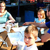 Debbie Blank | The Herald-Tribune<br /> Molly (Muething) and Shawn Ironmonger, Madeira, Ohio, and their kids (from left) Lizzy, 1; Luke, 5; and Hailey, 3, finish up Breakfast on the Square. Not pictured is 1 month-old Colleen. Izzy's at Hillcrest co-owner Adam Israell offered omelets made with local ingredients, hash browns, fruit and beverages.