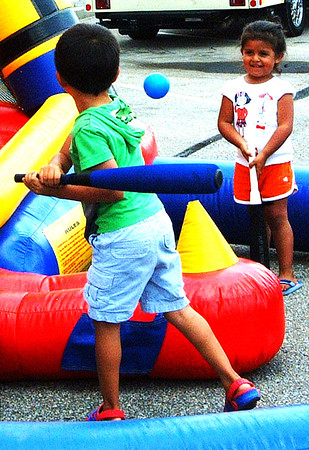 Debbie Blank | The Herald-Tribune<br /> Axel (left), 4, and Luna Conejo, 3, Batesville, play in the kids zone.