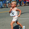 Debbie Blank | The Herald-Tribune<br /> No. 142 confidently strides to the finish line.