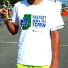 Debbie Blank | The Herald-Tribune<br /> Jacob Stenger, the son of Mark and Ann Stenger, receives a trophy for becoming the Fastest Boy in Town.