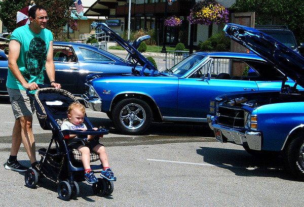 Debbie Blank | The Herald-Tribune<br /> Sam Wintz, Batesville, and grandson John Huckby, Cincinnati, check out the car show.
