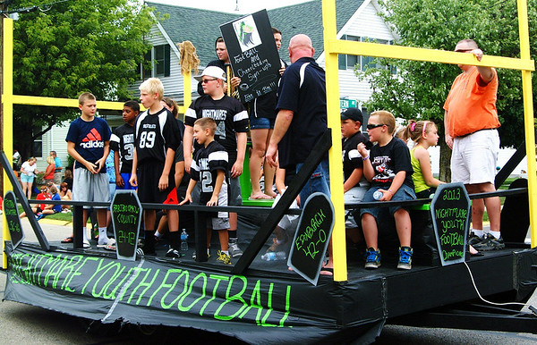 Christopher Aune | The Herald-Tribune<br /> NIGHTMARES, youth football league champions, were recruiting in the Firemen's Parade Saturday.
