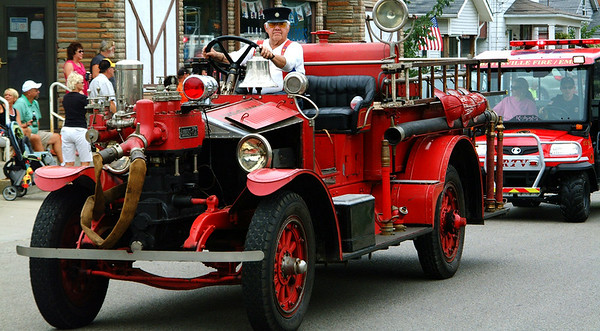 Christopher Aune | The Herald-Tribune<br /> A vintage firetruck driven by Mike Gutzwiller, Batesville, is followed by a modern addition to the Batesville Fire and Rescue Department.