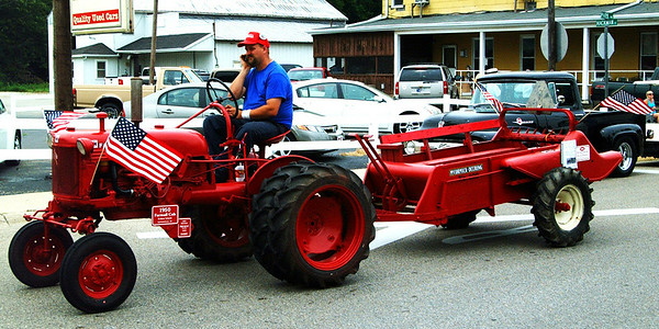 Christopher Aune | The Herald-Tribune<br /> Tractor enthusiasts enjoyed the sight of this 1950 Farmall Cub and McCormick-Deering spreader in the parade.