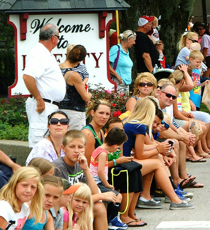 Christopher Aune | The Herald-Tribune<br /> During the parade, a crowd lines the streets across Batesville to Liberty Park, where the firemen's festival was celebrated July 11-12 to honor the city's rescuers and generate funds to support the department.
