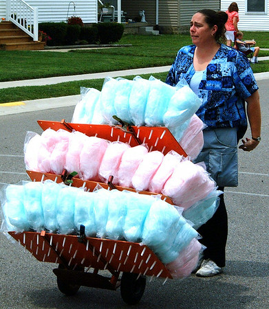 Christopher Aune   The Herald-Tribune<br /> Colorful cotton candy, homemade by Delia Magaras and her daughter, Cincinnati, was available during the parade.
