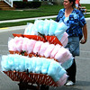 Christopher Aune | The Herald-Tribune<br /> Colorful cotton candy, homemade by Delia Magaras and her daughter, Cincinnati, was available during the parade.