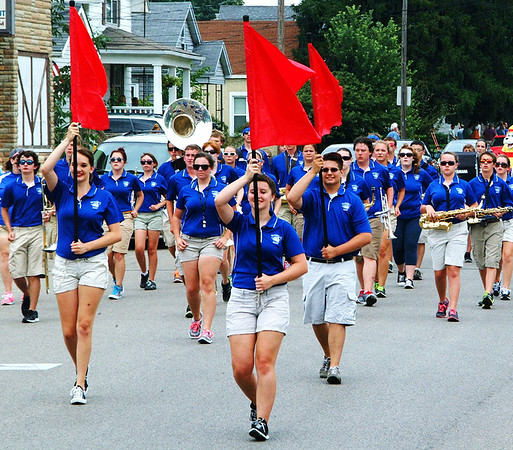 Christopher Aune | The Herald-Tribune<br /> The band wore blue from Batesville High School Bulldogs, playing during the Summerfest parade Saturday, July 12, to honor city firefighters and rescuers.