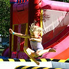 Christopher Aune | The Herald-Tribune<br /> Joy comes in small packages: Calli Fletcher, daughter of firefighter Cory and Mara Fletcher, jumps over moving barriers of the Meltdown machine at the Summerfest.