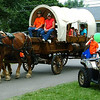 Christopher Aune | The Herald-Tribune<br /> A replica of a historical Conestoga wagon is welcomed to Liberty Park, where the parade ended and the festivities continued.