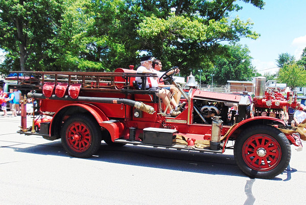 Debbie Blank | The Herald-Tribune<br /> A vintage firetruck reminded area residents how blazes used to be fought.