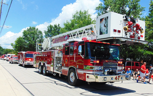 Debbie Blank | The Herald-Tribune<br /> Close to 20 firetrucks and rescue vehicles from not just Batesville, but also Oldenburg, Sunman and Morris, excited the crowd on Mulberry Street and elsewhere along the parade route.