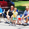 Debbie Blank | The Herald-Tribune<br /> Andrew Miller (standing), 4, admires a firetruck with (from left) grandfather Vern Moody and parents Tammy and Scott. All live in Batesville.