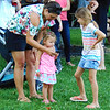 Debbie Blank | The Herald-Tribune<br /> Sandy Thurston, New Point, checks out a cellphone photo with daughter Iris, 2, and niece Oakley Ertel, 9.