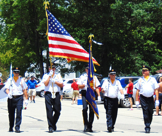 Debbie Blank | The Herald-Tribune<br /> The Batesville Fire & Rescue Summerfest parade is led by the Batesville Veterans of Foreign Wars Post 3183 honor guard carrying flags.