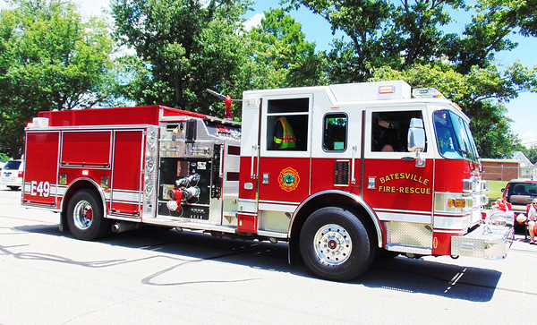 Debbie Blank | The Herald-Tribune<br /> Many Batesville firetrucks were on display in the procession.