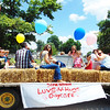 Debbie Blank | The Herald-Tribune<br /> Balloons decorated the Luvs-N-Hugs Daycare float.