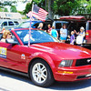 Debbie Blank | The Herald-Tribune<br /> State Rep. Randy Frye waves to the crowd from behind the wheel.