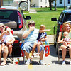 Debbie Blank | The Herald-Tribune<br /> A Batesville clan watches the parade. Mom Lauren Ronnebaum (from left) holds Penelope, 1 month; grandmother Lisa Ronnebaum has Bentley Ronnebaum, 1; dad Adam Ronnebaum has Abigail, 3; mom Christine Lacey cradles Lexy, 1, with husband Bryan.