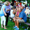 Debbie Blank | The Herald-Tribune<br /> Janet and Roger Kirschner (standing), Batesville, visit with friends Saturday night.