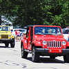 Debbie Blank | The Herald-Tribune<br /> Colorful jeeps were part of the procession.