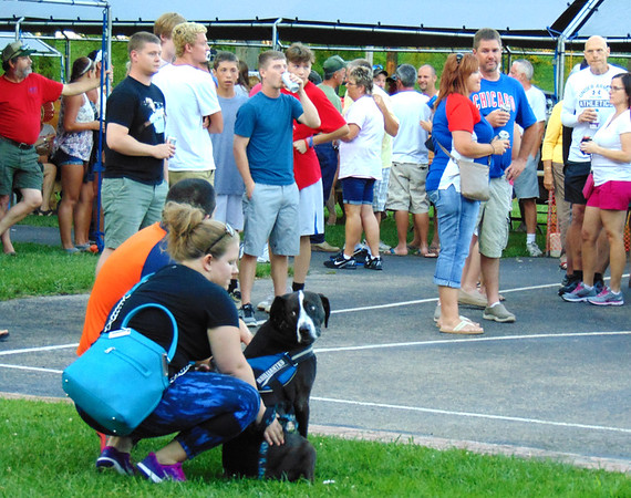 Debbie Blank | The Herald-Tribune<br /> A dog joined humans to enjoy the music of 5 Lights.