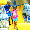 Debbie Blank | The Herald-Tribune<br /> An inflatable was a popular place for kids to gather Saturday night at the Batesville Fire-Rescue fundraiser at Liberty Park.