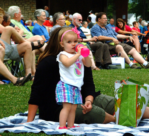 "Debbie Blank | The Herald-Tribune<br /> Young music fan Madelyn Bartal, 18 months, Batesville, enjoys a bottle while listening to Lydia McAdams sing ""The Man I Love."""