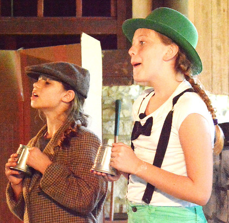 "Debbie Blank | The Herald-Tribune These two young ladies did a terrific job portraying the lead characters in ""The Adventures of Frog and Toad,"" which kicked off Thursday entertainment at Liberty Park."